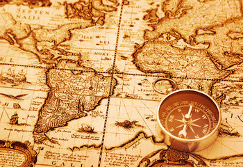 Compass on vintage map background
