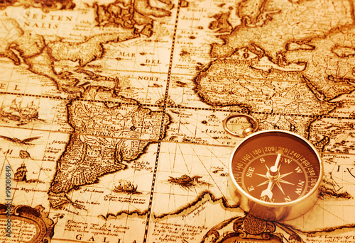 Photo  Compass on vintage map background