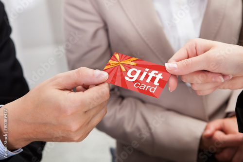 Photo  Businessperson Hands Giving Gift Card To Other Businessperson