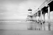 Black And White Photo Of Ocean Pier With Small Waves