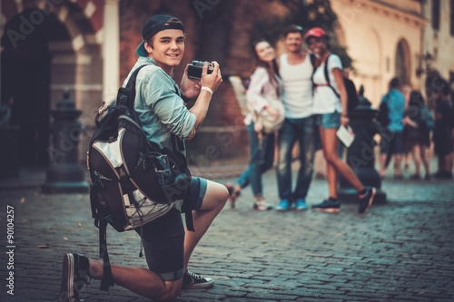 Multiracial friends tourists taking picture in an old city