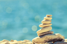 Stones Balance At The Beach, Stack Over Blue Sea