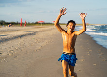 Happy Boy Running On The Sea B...