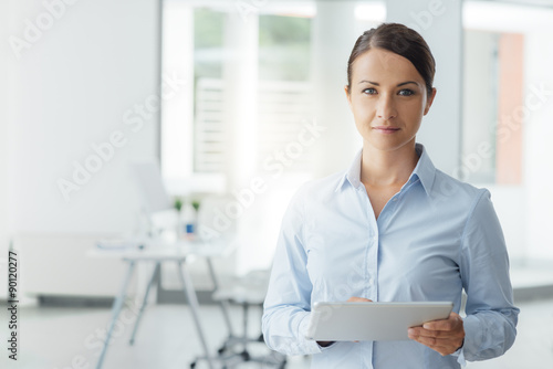 Business woman posing with a digital tablet