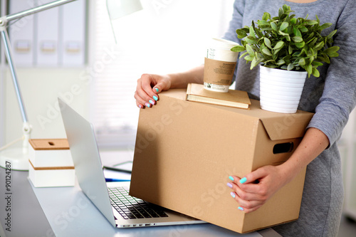 Happy team of businesspeople moving office, packing boxes Canvas Print