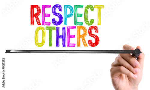 Canvas Print Hand with marker writing the word Respect Others