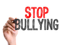 Hand With Marker Writing The Word Stop Bullying
