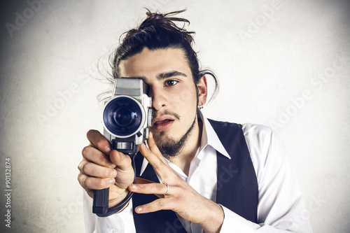 Photo  Man with Videocamera
