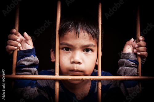 Fotografia, Obraz  asian boy Hand in jail,vintage tone