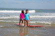 Girl at the ocean surfing