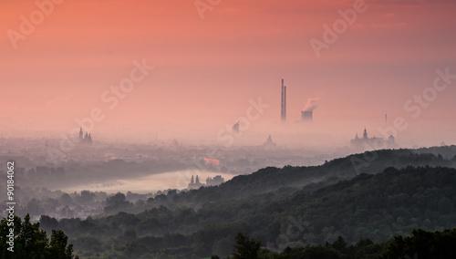 Fototapeta Krakow city in delicate fog seen in the morning from the Pilsudski Mound. obraz