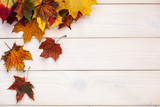 Fototapeta Tulipany - Autumn background with colorful leaves on wooden background