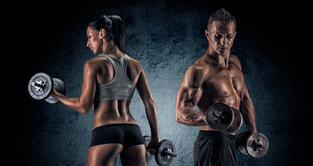 Fototapeta Fitness / Siłownia Athletic man and woman with a dumbells.