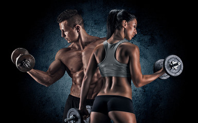 Fototapeta na wymiar Athletic man and woman with a dumbells.