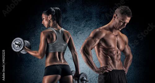 Spoed Foto op Canvas Fitness Athletic man and woman with a dumbells.