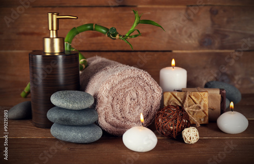 Beautiful spa composition with candles on wooden background