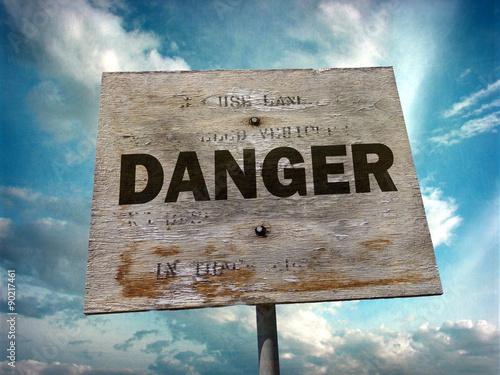 Fotografie, Obraz  aged and worn vintage photo of wooden danger sign