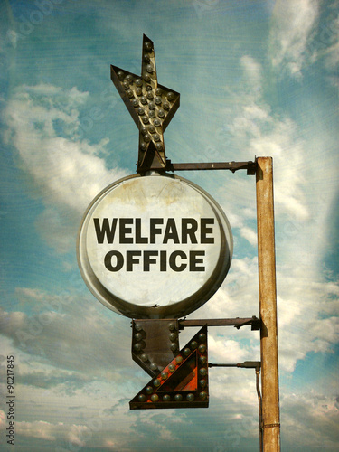 aged and worn vintage photo of welfare office sign - Buy this stock