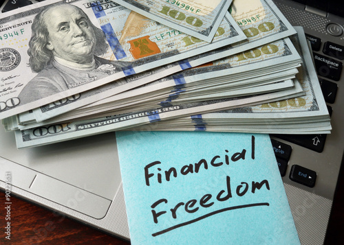 Photo  Financial Freedom  written on notebook with charts.