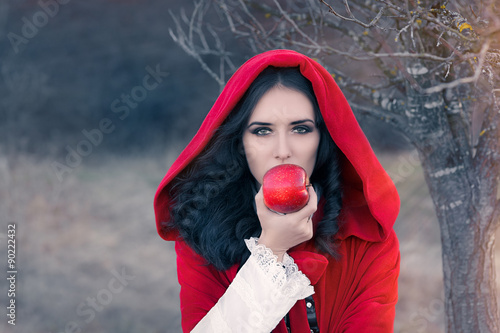 Fotografie, Obraz  Red Hooded Woman Holding Apple Fairytale Portrait