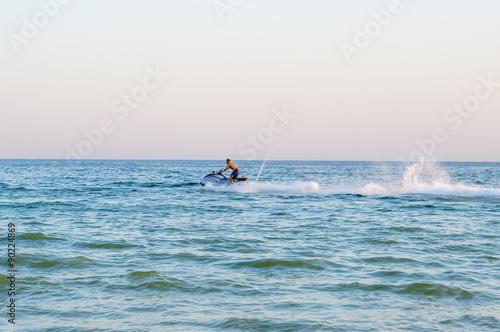 Poster Nautique motorise Man on jetski floating in sea