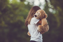 Girl Hugging A Bear
