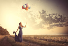 Girl In Blue Dress With Bouquet And Balloons
