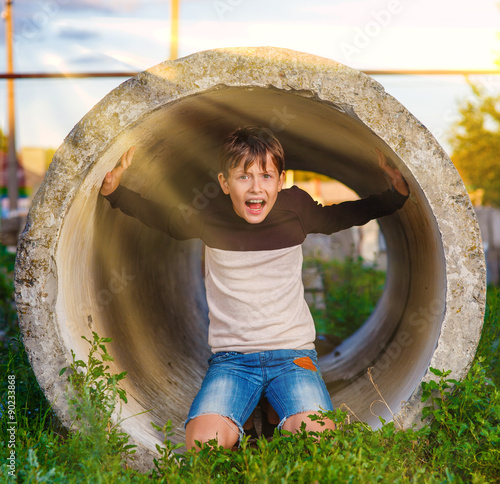 Teen boy shouts in a tube claustrophobia agoraphobia mental illn Canvas Print