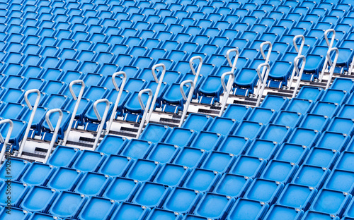 Papiers peints Stade de football rows of blue seats in a stadium