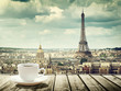 background with cup of coffee and Eiffel tower in Paris
