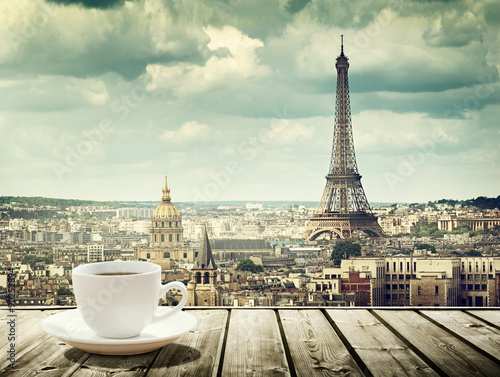 background with cup of coffee and Eiffel tower in Paris Fototapete