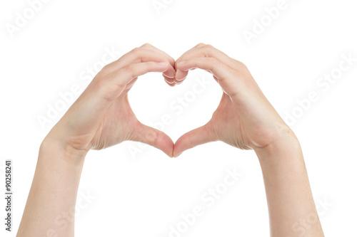 Photo femme formant un coeur avec ses mains