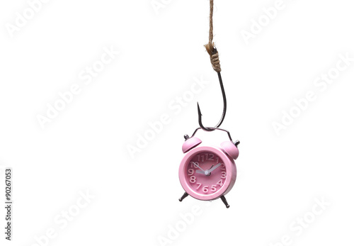 Fényképezés a clock hung on a fish hook / time trap concept