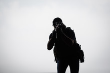Silhouette Of Terrorist With A...