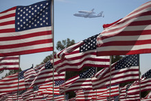 The Final Flight Of The Space Shuttle Columbia Flies On 9/21/12 Over US Flags At Peperdine University In Malibu, CA.
