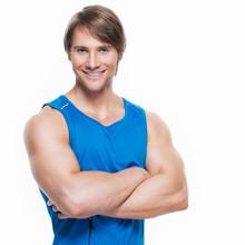 Handsome Happy Sportsman In Blue Shirt.