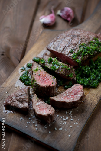 Medium rare grilled barbecue beefsteak with chimichurri sauce Poster