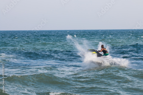Papiers peints Nautique motorise Man on jet ski with high speed and adrenalin.