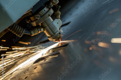 Poster de jardin Metal Laser cutting of metal sheet, close-up