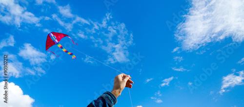 Fotografie, Obraz  Hands holding kite