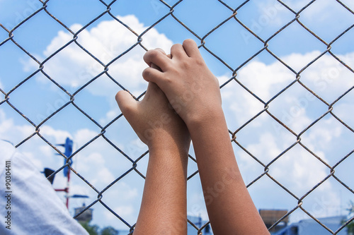 Fotografie, Obraz  asian girl hand hold jail