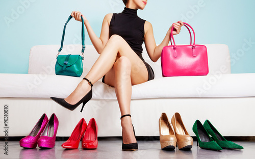 Obraz Woman choosing bags and shoes. Fashion and shopping. Colorful collection. - fototapety do salonu