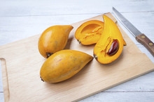Pouteria Campechiana On Wooden Cutting Board