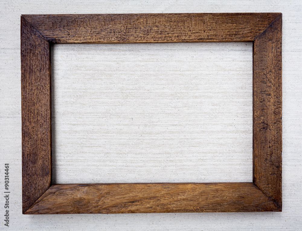 Fototapeta Wooden picture frame on canvas background