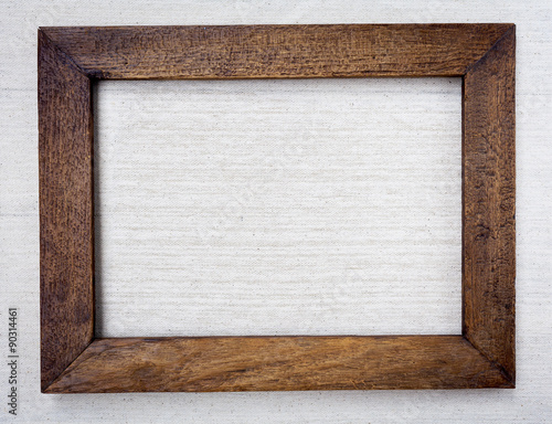 Fotografía  Wooden picture frame on canvas background