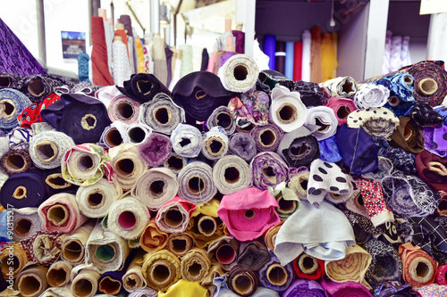 fabric on sale in a street market, filtered Wallpaper Mural