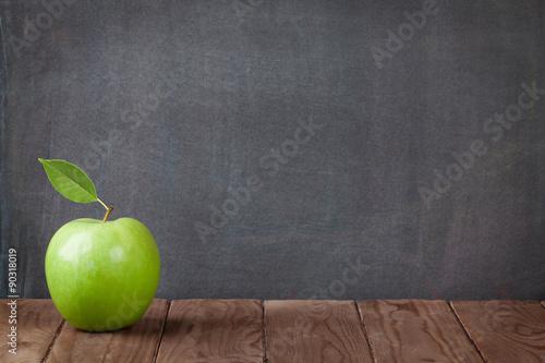 Fototapeta Apple fruit on classroom table obraz