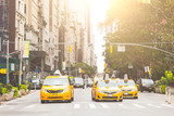 Fototapeta Nowy Jork - Typical yellow taxi in New York city