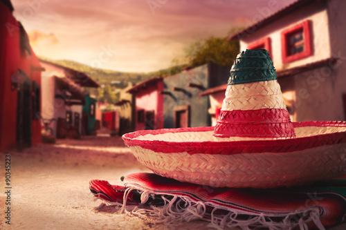 "Fotografía  Mexican hat ""sombrero"" on a ""serape"" in a mexican village at sun"