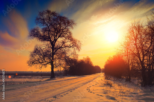 Poster Oranje eclat Rural winter landscape at sunset